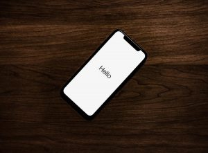 iphone hello wooden table