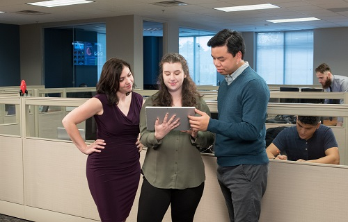 Technology Team Collaborating on a tablet computer in an office